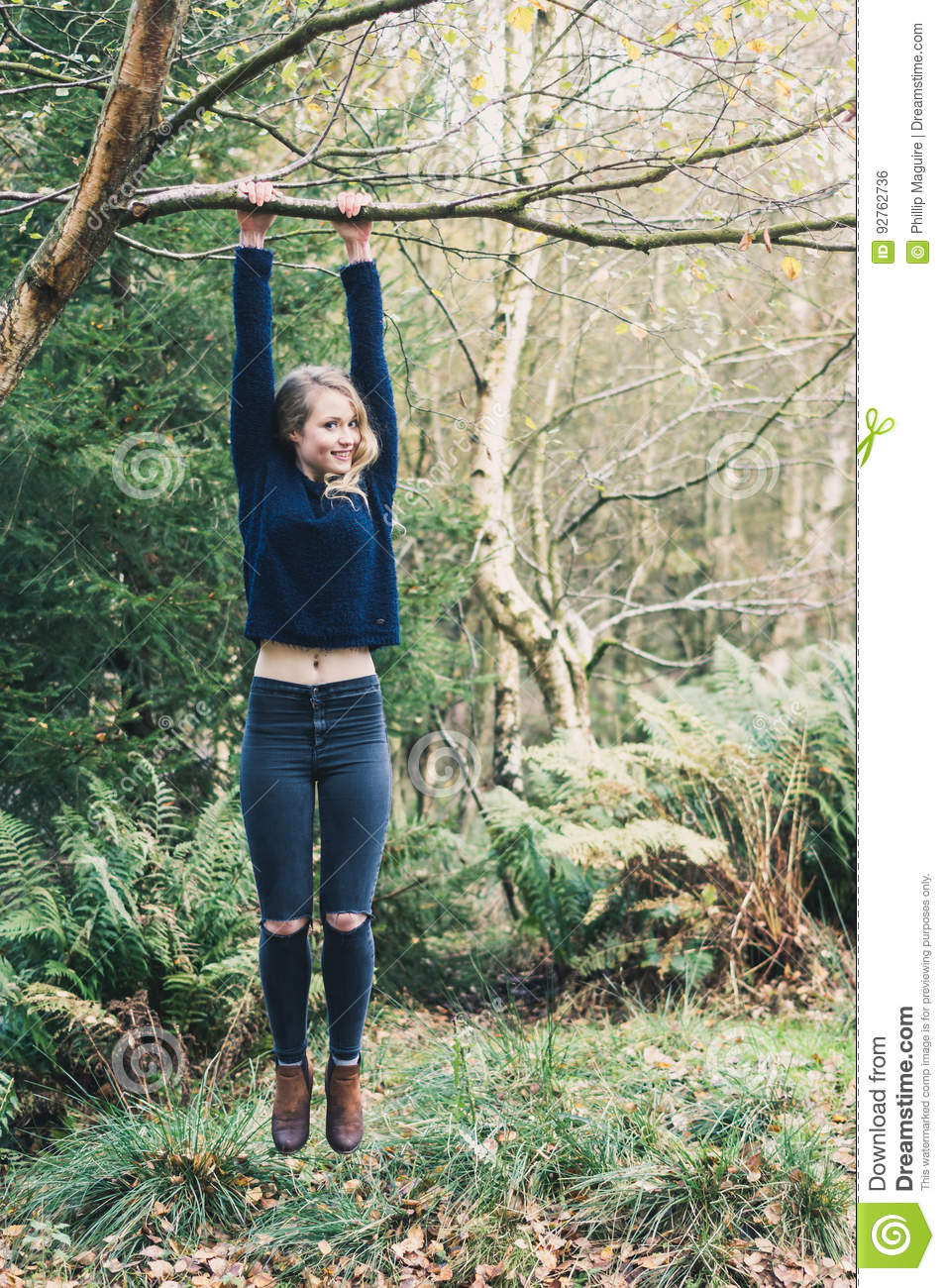 Young Woman Holding Onto Tree Stock Photo - Image Of Face -4268