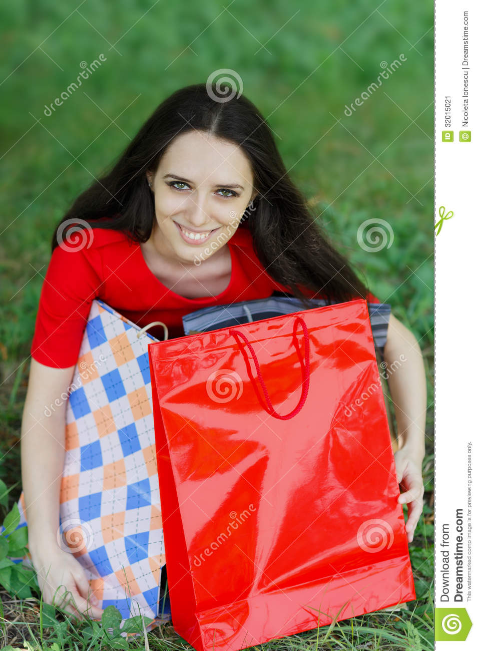 Excellent Asian Woman Wearing Apron And Holding Grocery Bag View Large Photo