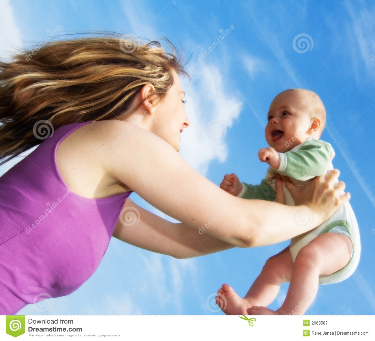 Young Woman Holding Up Baby