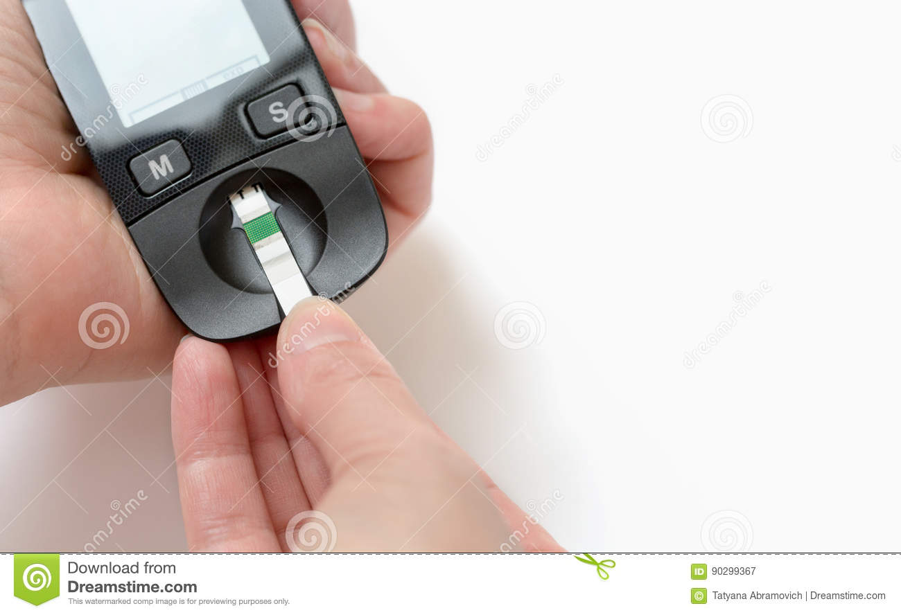 A young woman holds a glucometer in her hands and wants to do a blood test for sugar