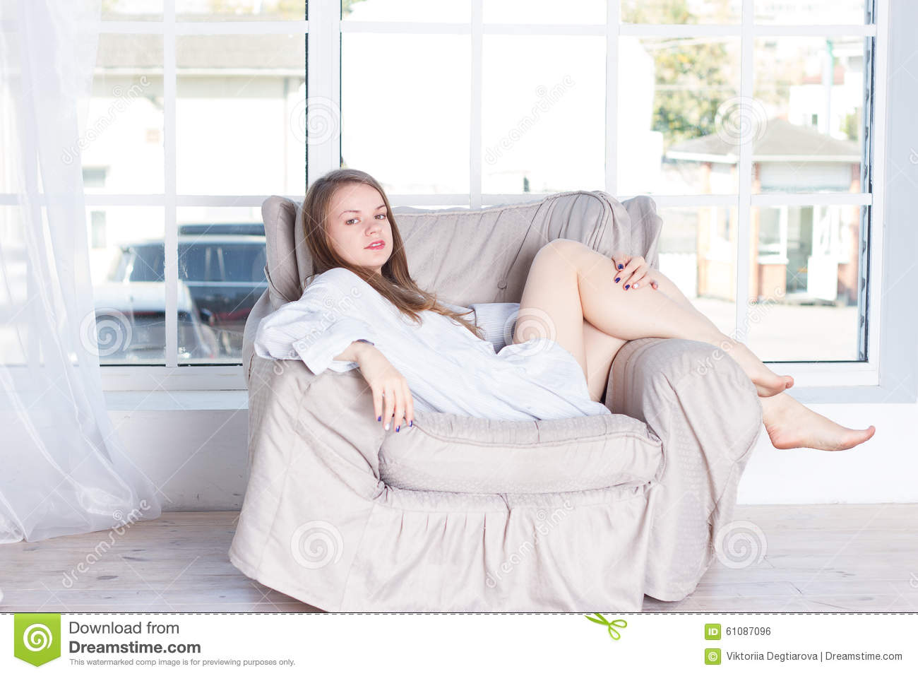Young Woman At Home Sitting On Modern Chair Stock Photo Image 61087096