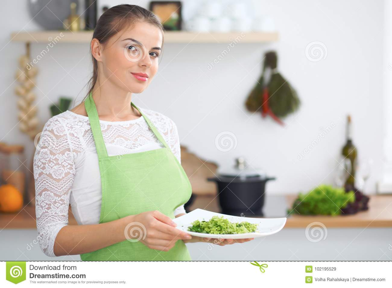 Young Woman Housewife Cooking In The Kitchen. Concept Of Fresh And ...