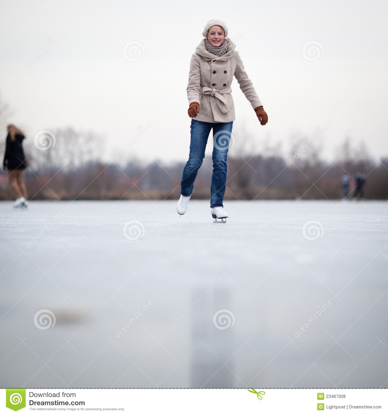 Young Woman Ice Skating Outdoors On A Pond Stock Photo ...