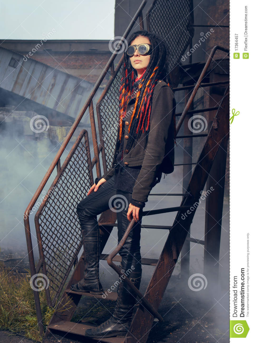 Young Woman In Industrial Style Standing On Stairs Stock Image