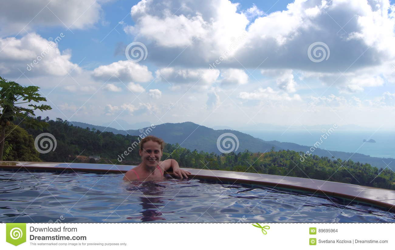 Young Woman In Infinity Edge Swimming Pool Stock Footage ...