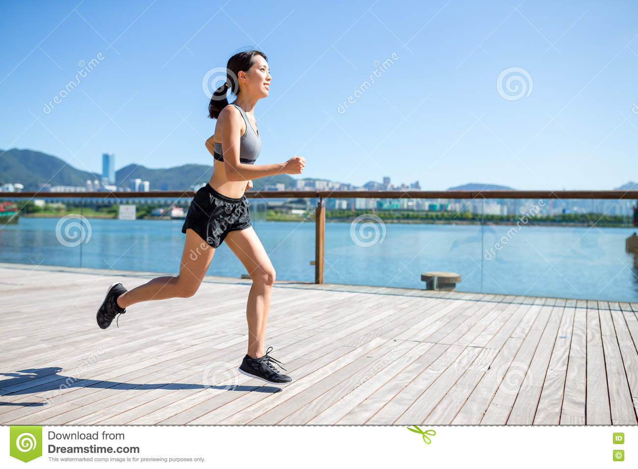 Young Woman Jogging On The Boardwalk Stock Image Image Of