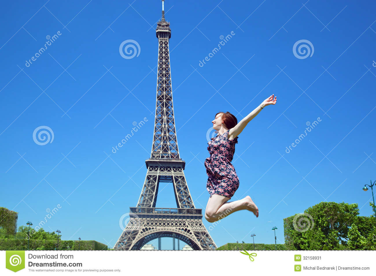 Young woman jumping against eiffel tower stock image image 32158931