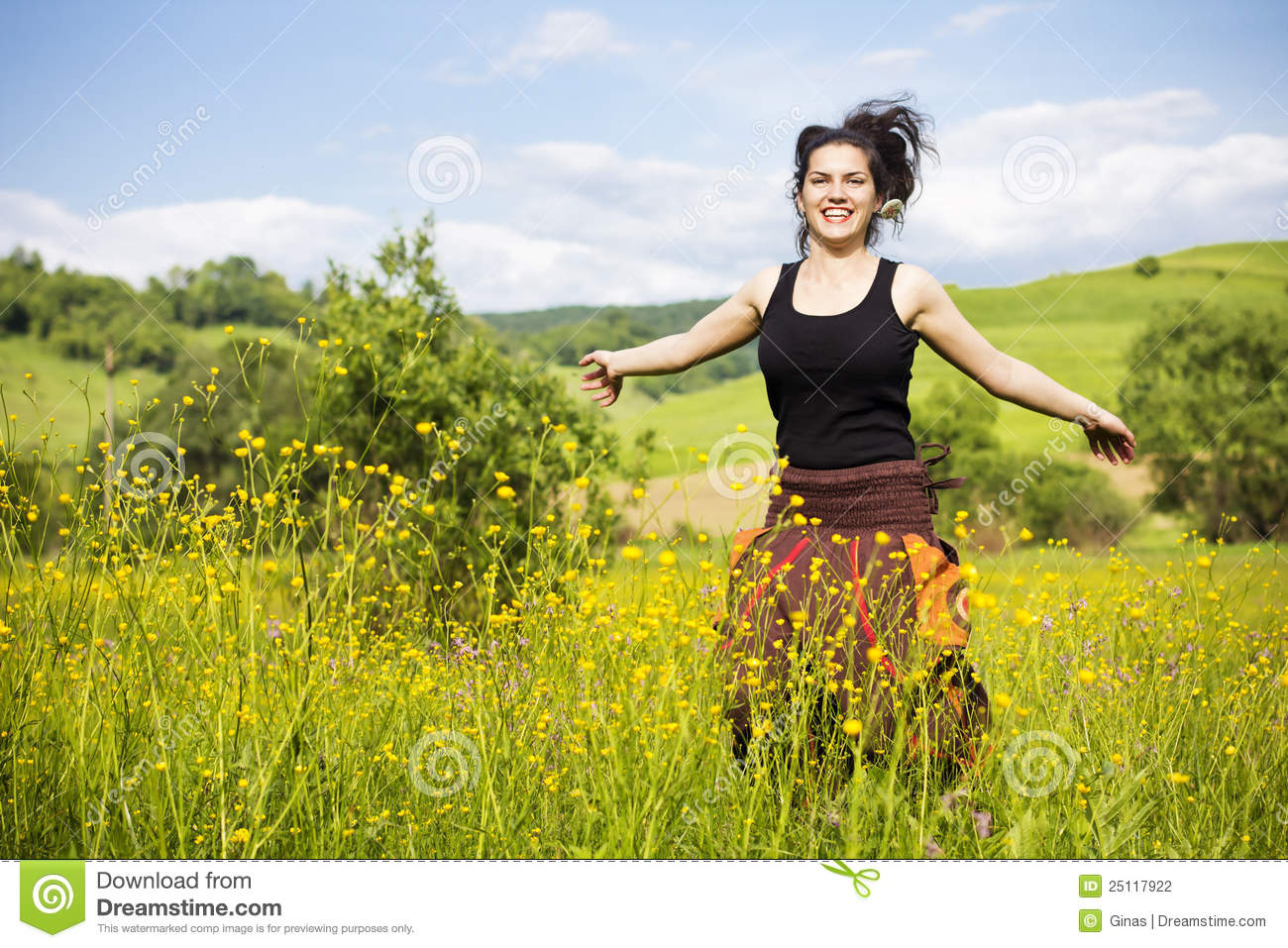 Young Woman Jumping In A Field Of Flowers Stock ...