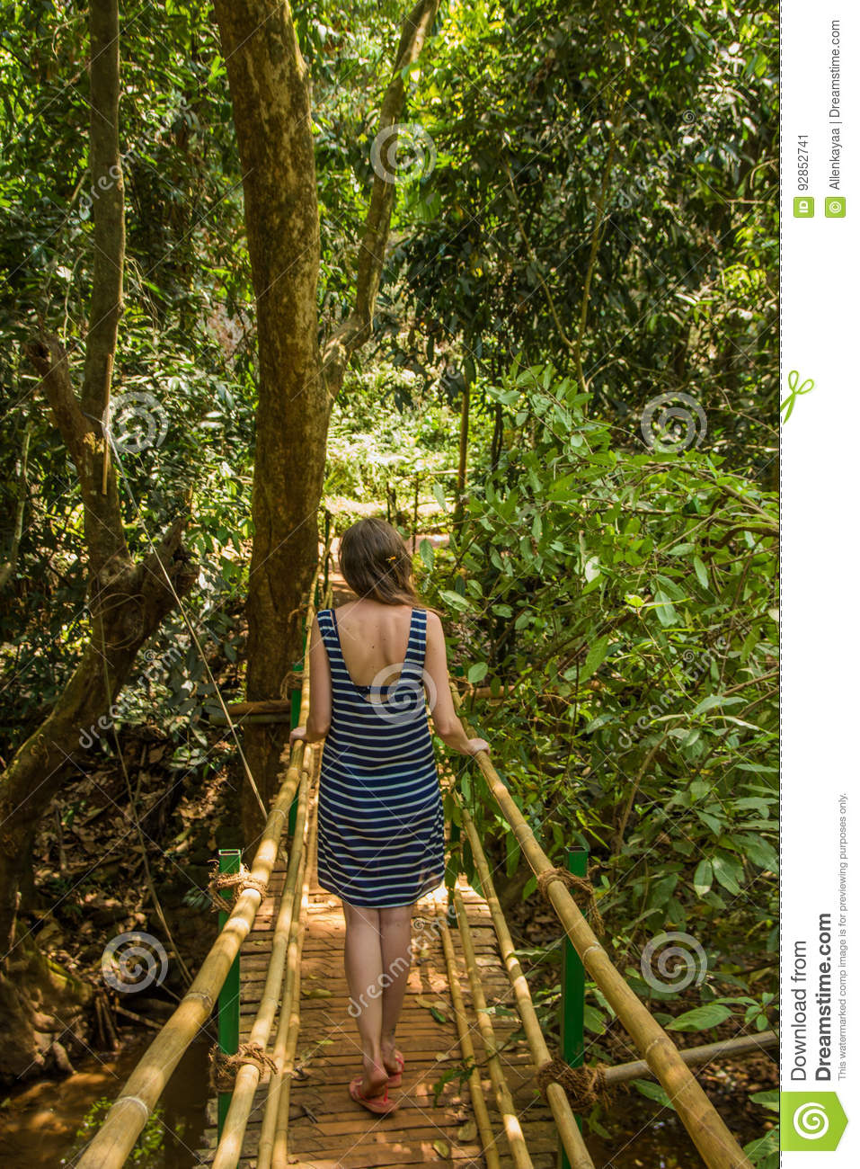 Young Woman In The Jungle On The Bridge In Tropical Spice Plantation