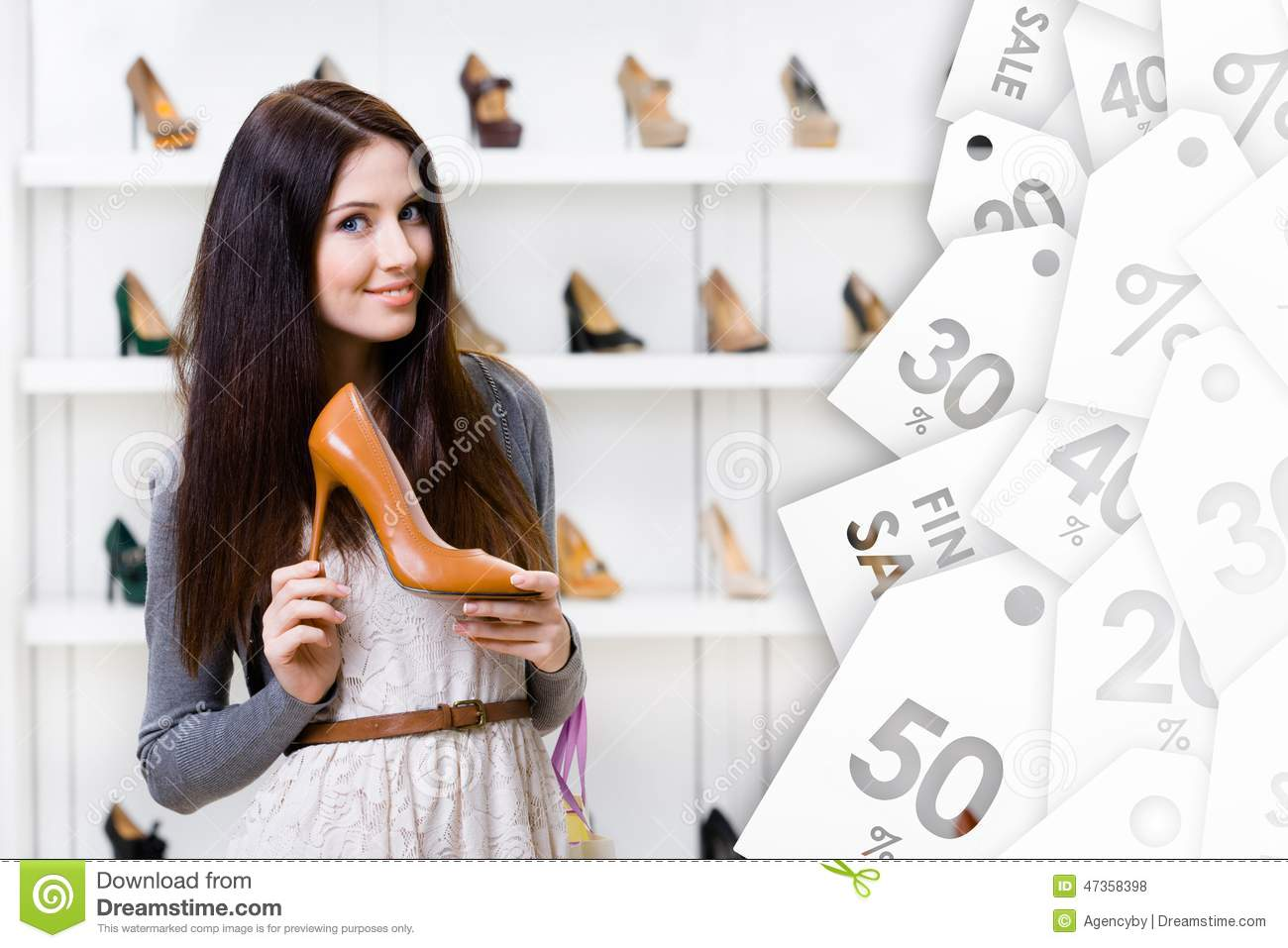 Young woman keeping high heeled shoe on sale