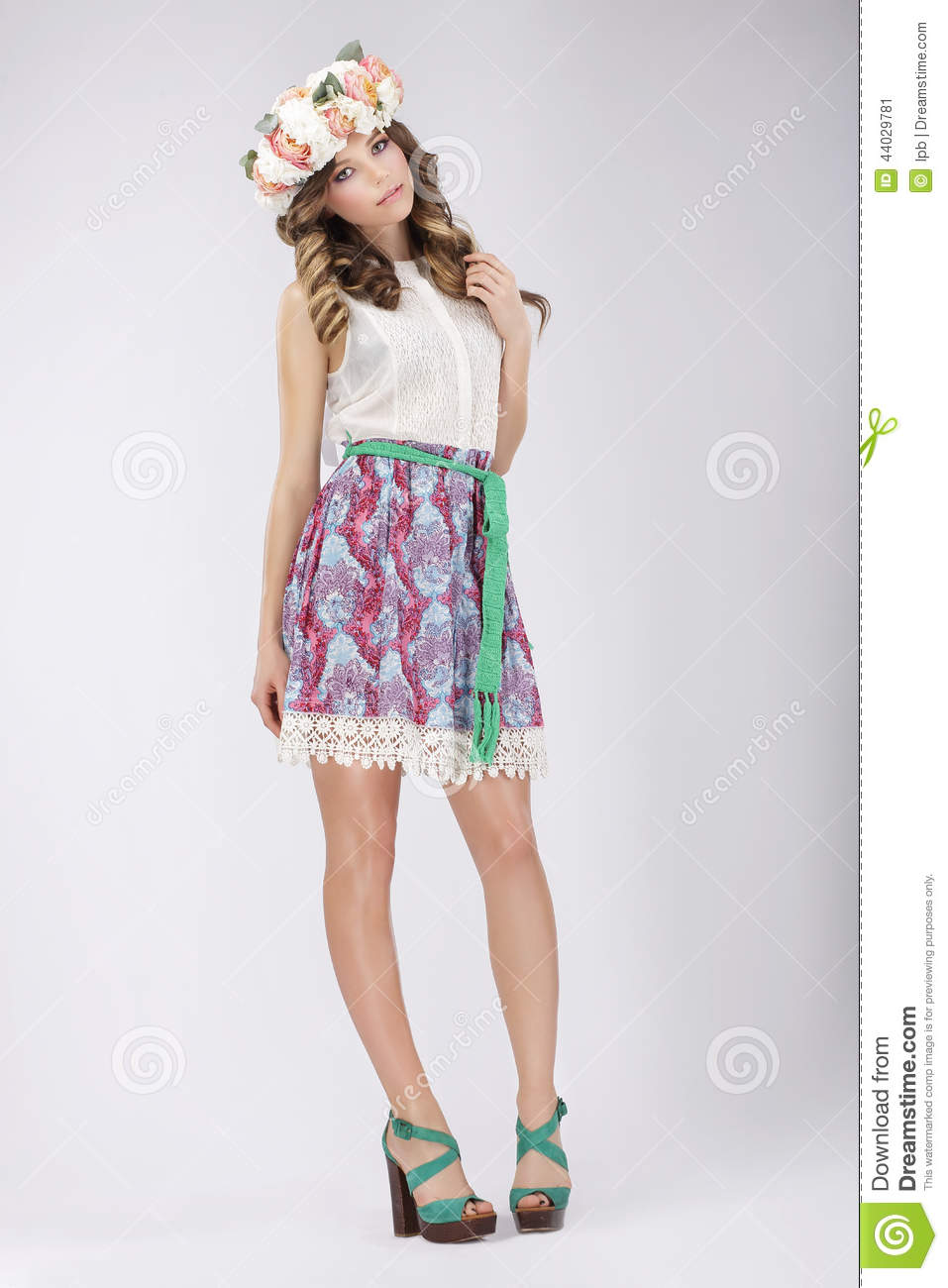 Young Woman in Lacy Skirt and Blouse with Flowers