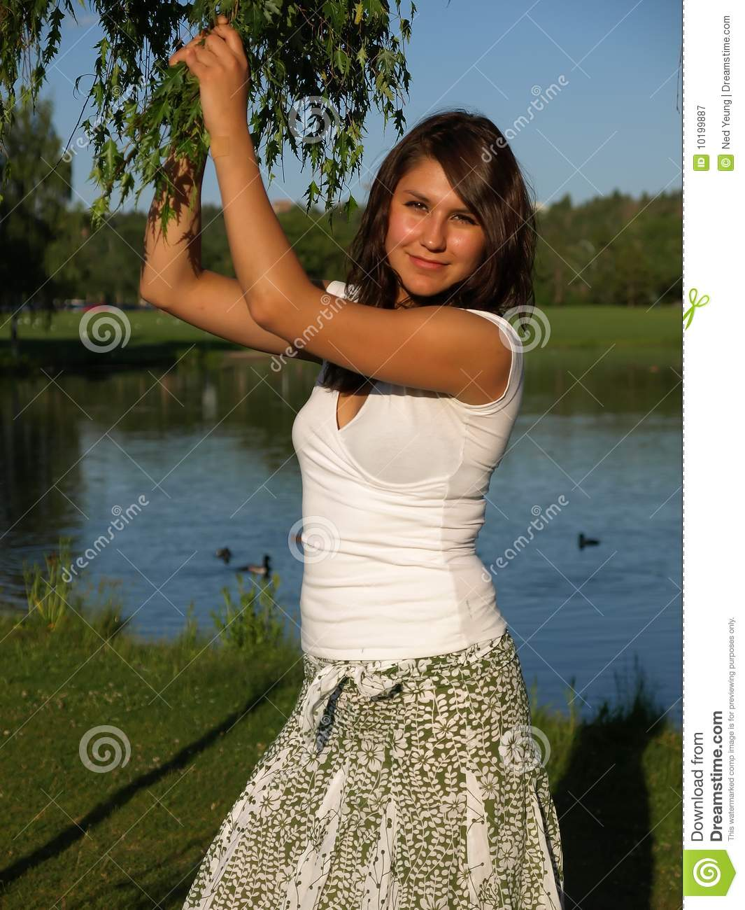 Young Woman by the lake with a tree