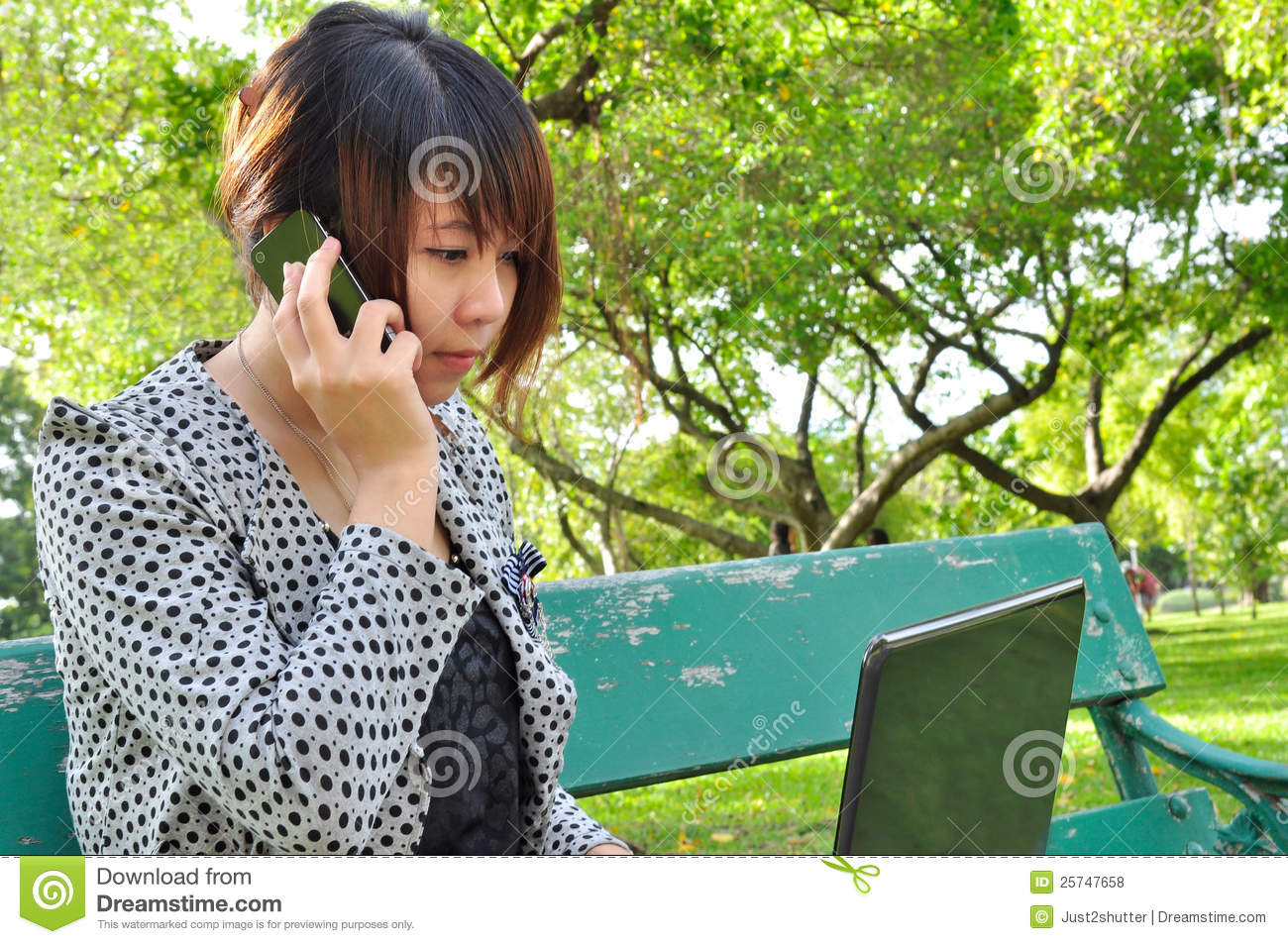 Young woman with laptop and mobile phone