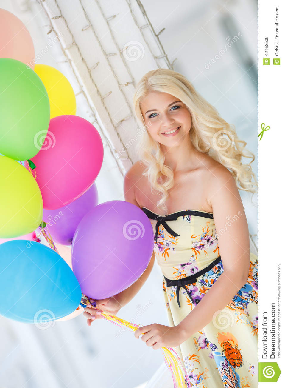 A Young Woman With Large Colourful Latex Balloons Stock ...