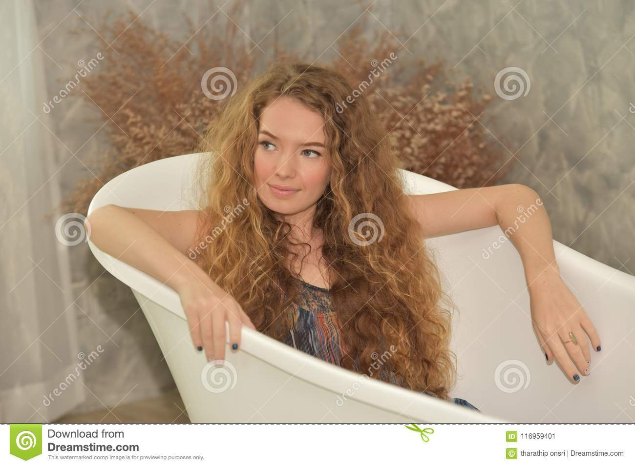 Young woman laying in bathtub.relaxed time