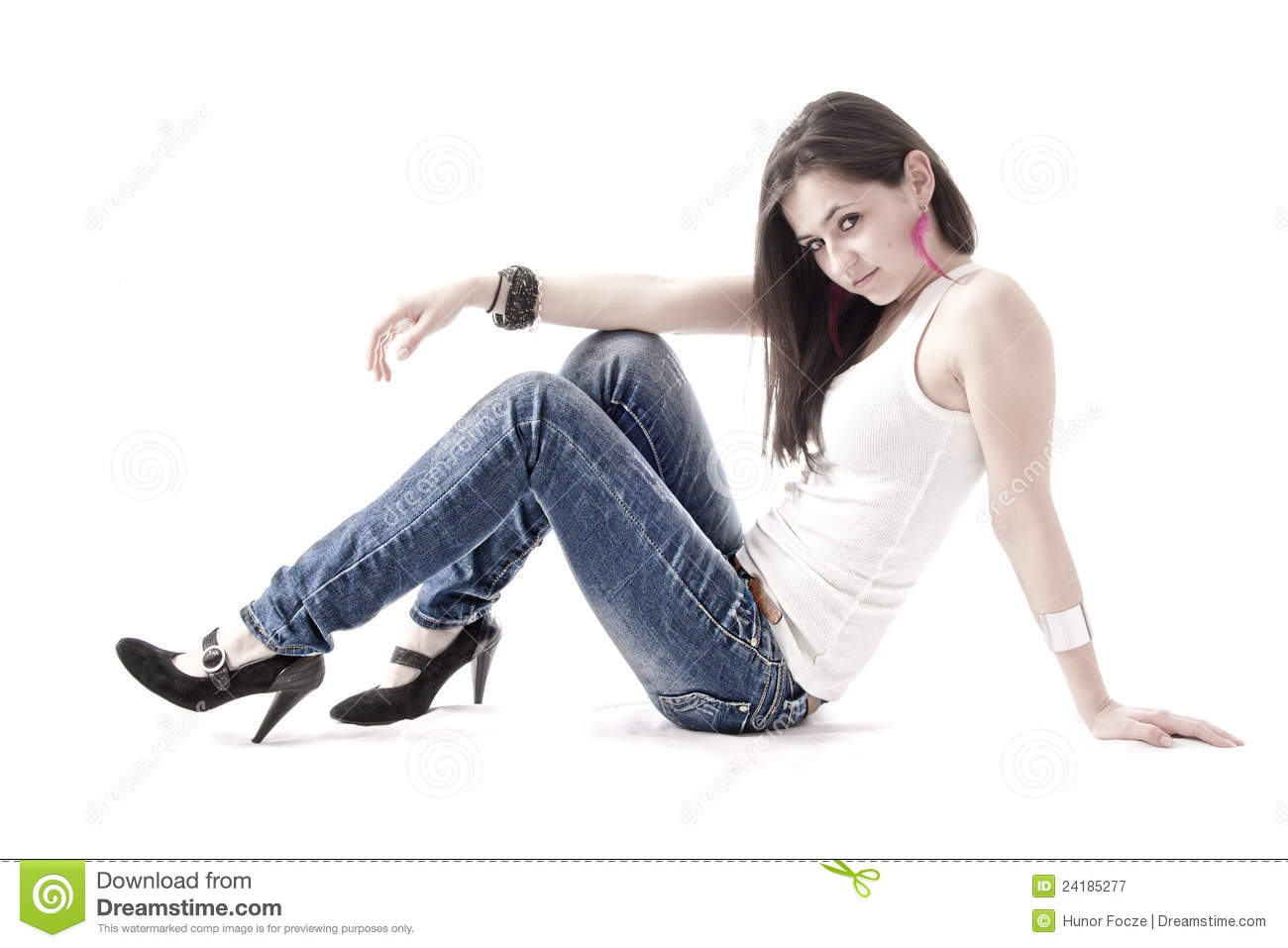 Young woman laying on the floor, isolated