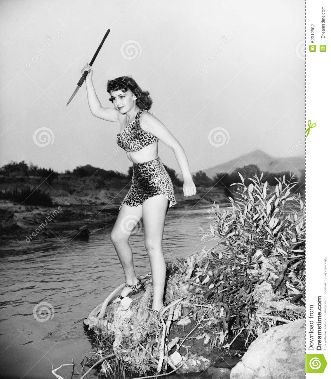 Download Young Woman In Leopard Skin With A Spear Stock Photo - Image of hunt, caucasian: 52012902