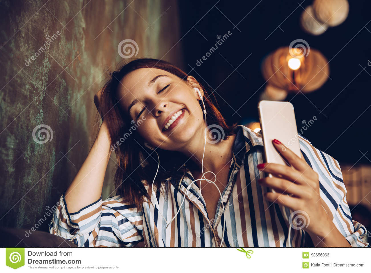 Download Young Woman Listen Music With Headphones And Relaxing. Sitting On Cafe Stock Image - Image of domestic, carefree: 98656063
