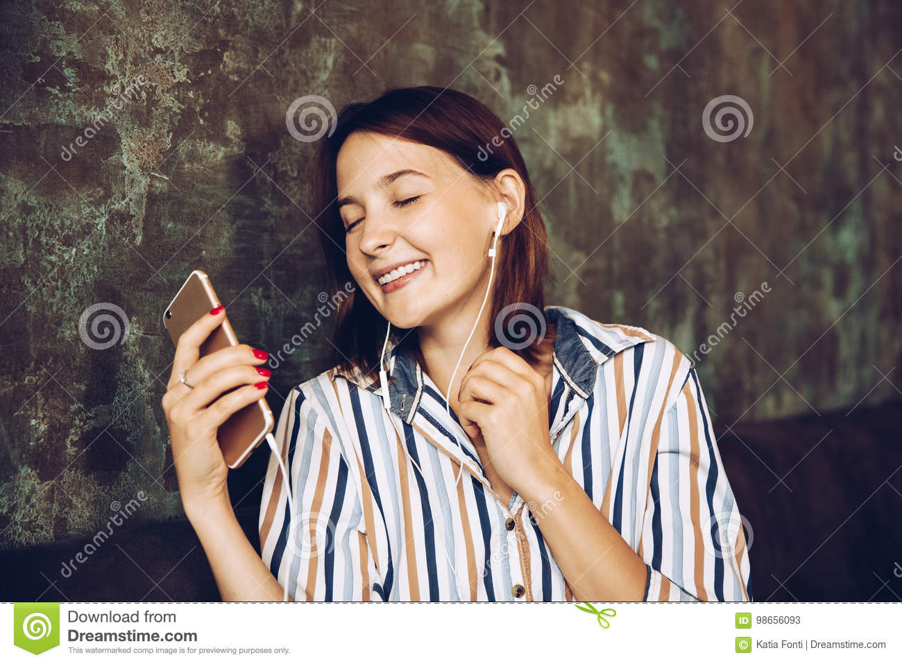 Young woman listen music with headphones and relaxing. Sitting on cafe, domestic atmosphere. Positive emotion,
