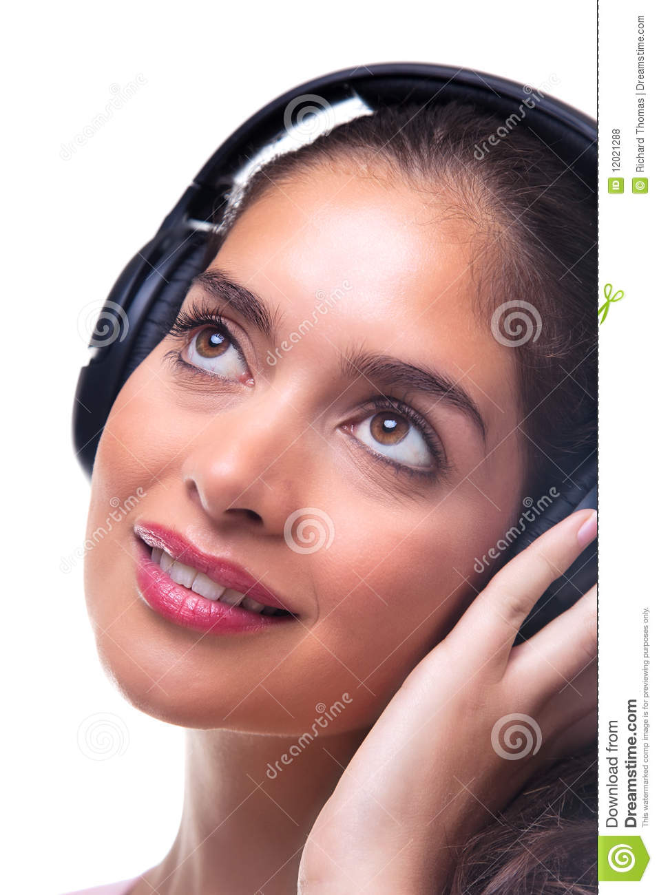 Young Woman Listening To Music Through Headphones. Stock ...