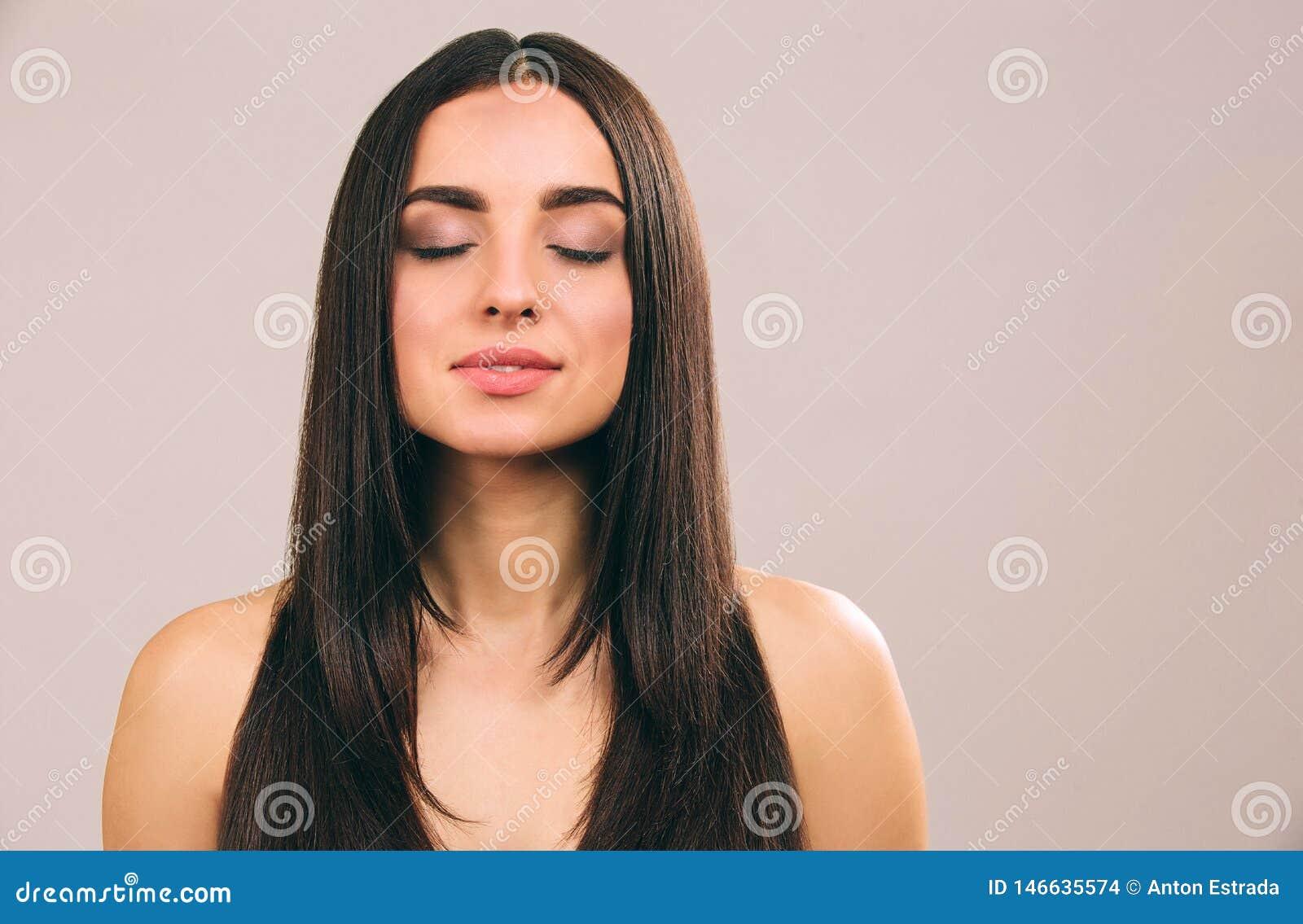 Peaceful Brunette In White Summer Dress Posing Stock Photo
