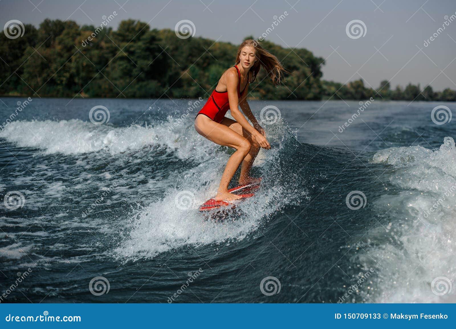 Girl in swimsuit on board in sea