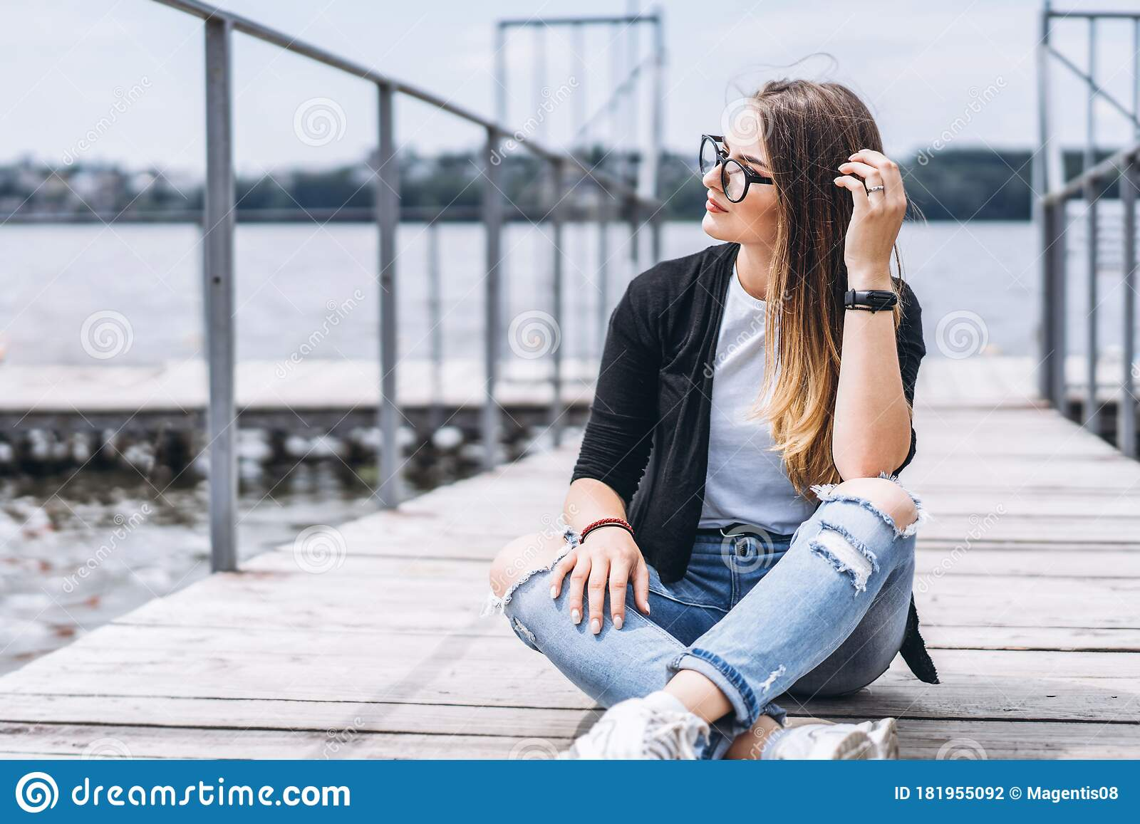 Young Woman With Long Hair In Stylish Glasses Posing On