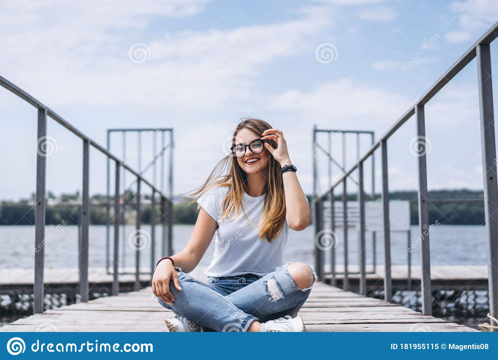 Young Woman With Long Hair In Stylish Glasses Posing On A