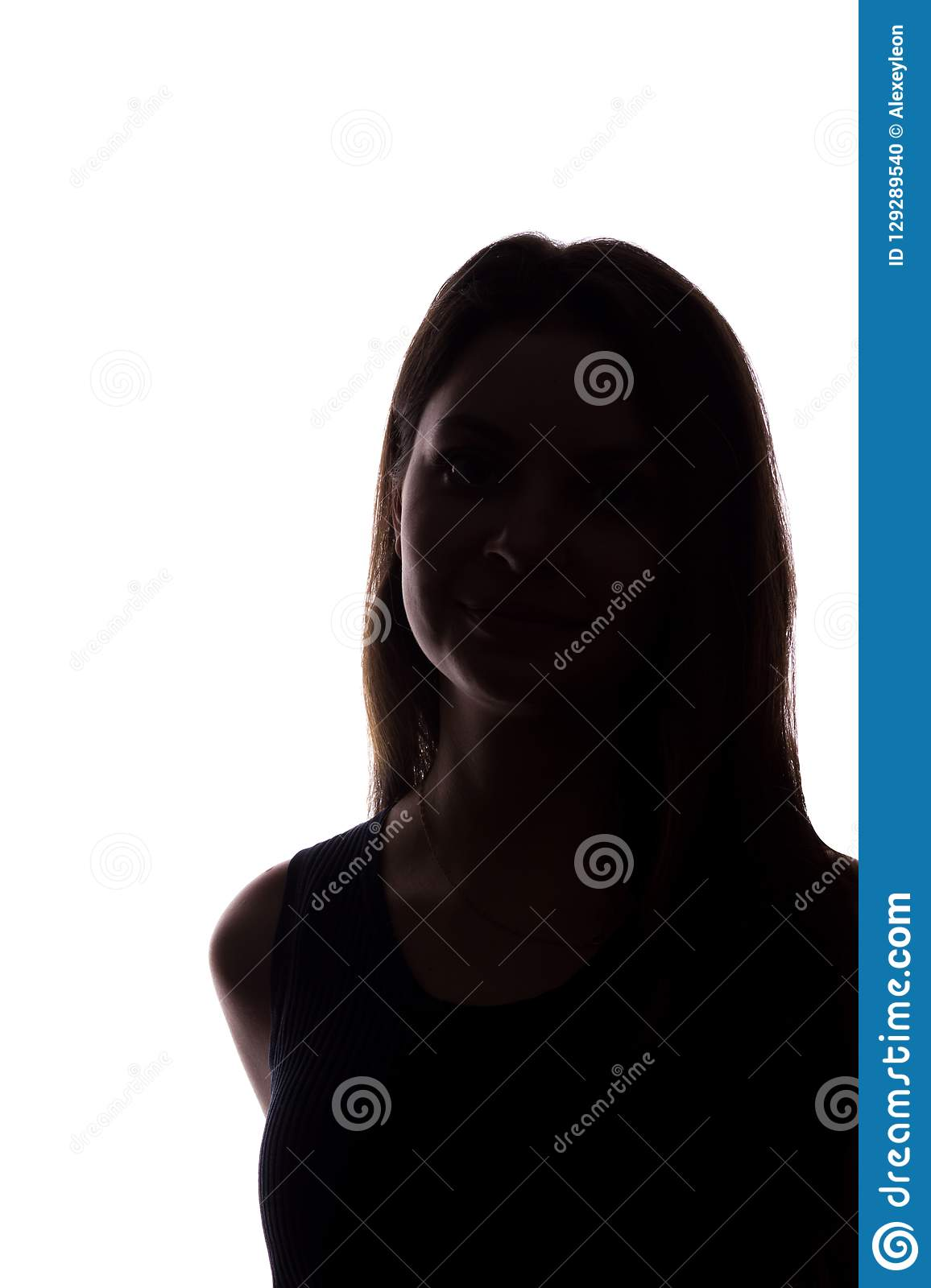 Young woman look ahead with flowing hair - vertical silhouette