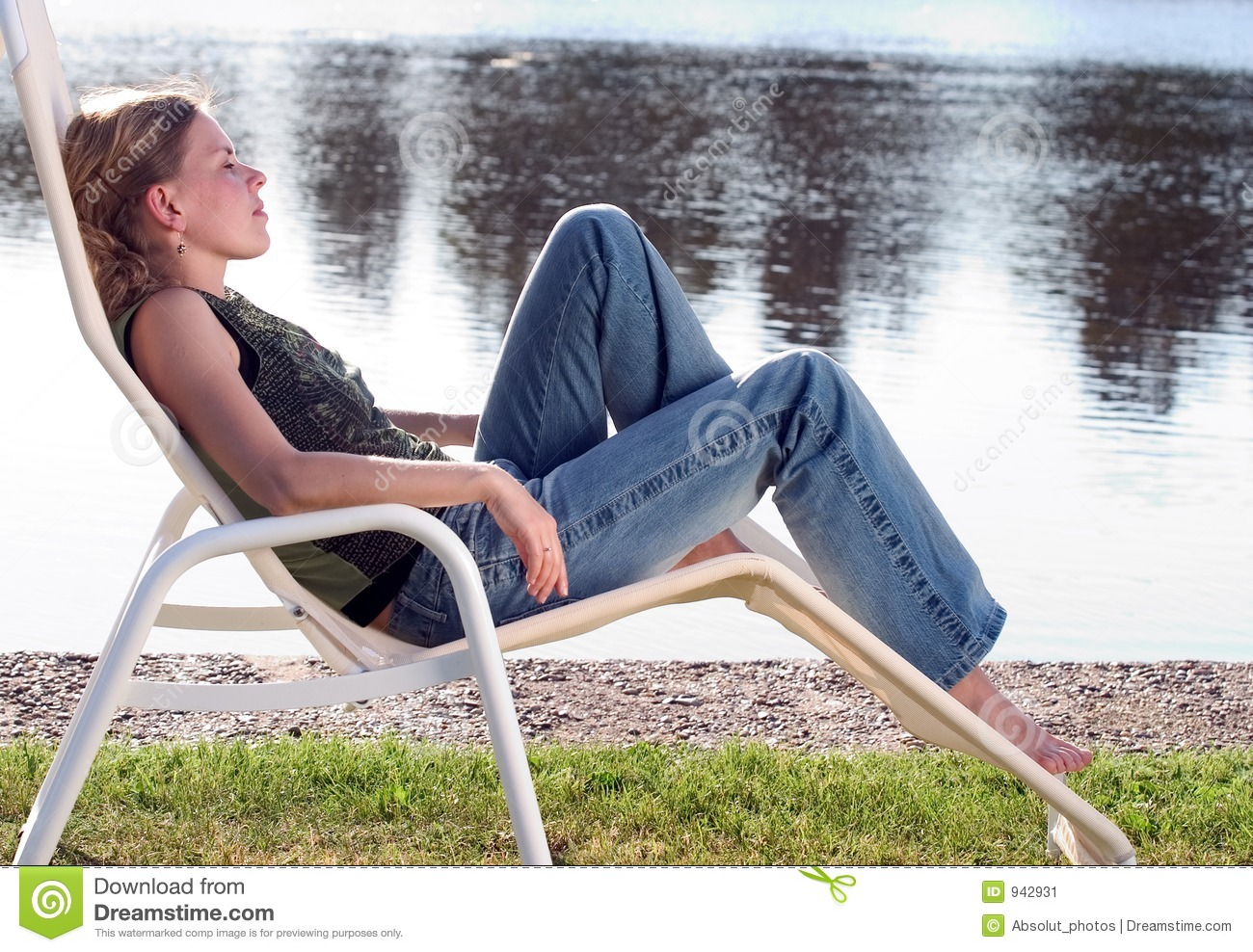 Young Woman Lounging In A Deck Chair Stock Image Image