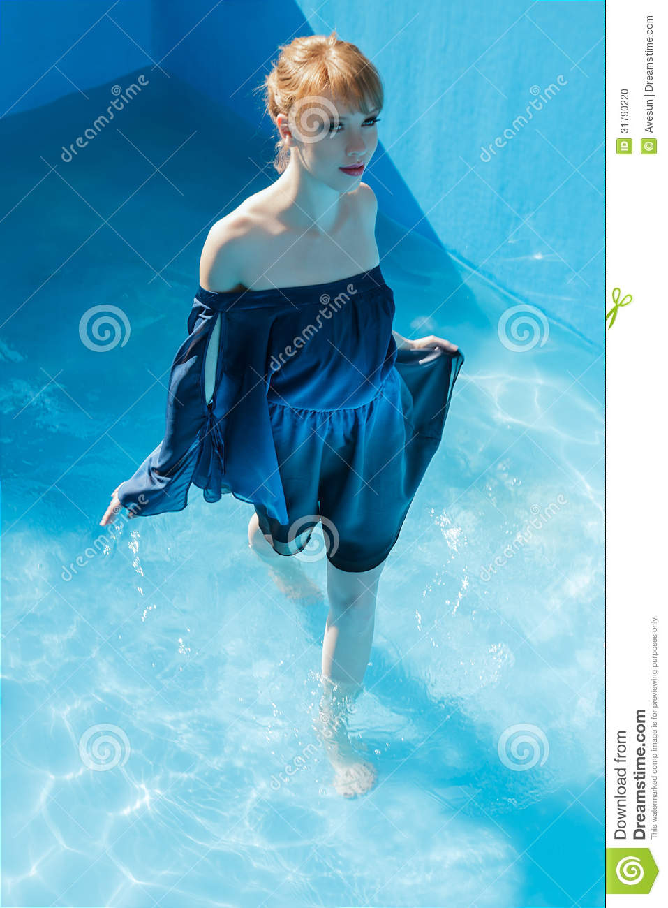 young woman in luxurious blue dress stock photo image 31790220