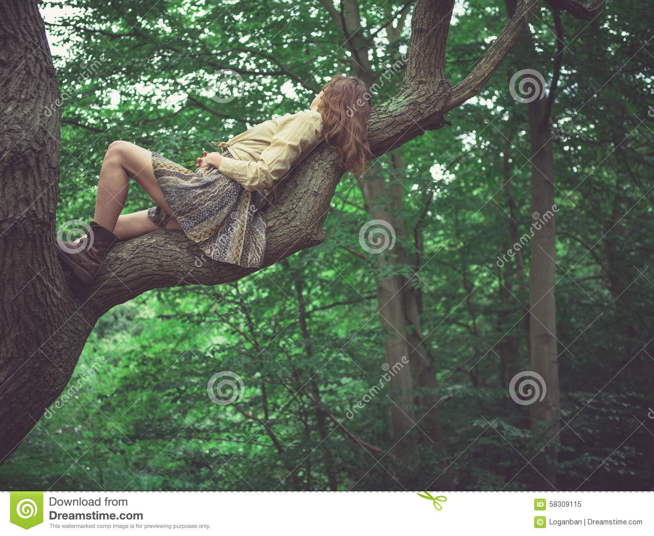 young-woman-lying-tree-branch-forest-583
