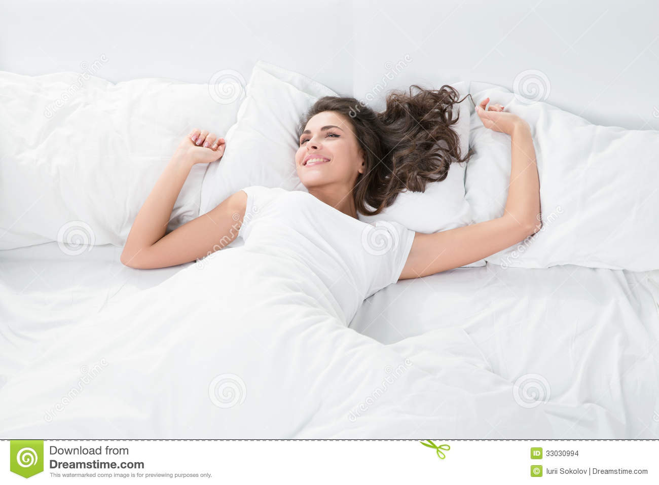 young woman lying on the white linen in bed stock images image 33030994. Black Bedroom Furniture Sets. Home Design Ideas