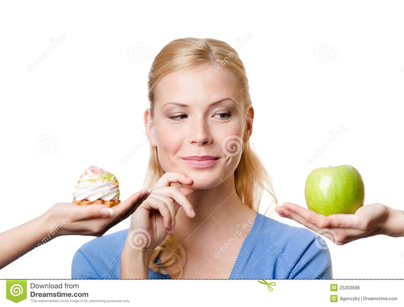 Young woman makes a choice between cake and apple