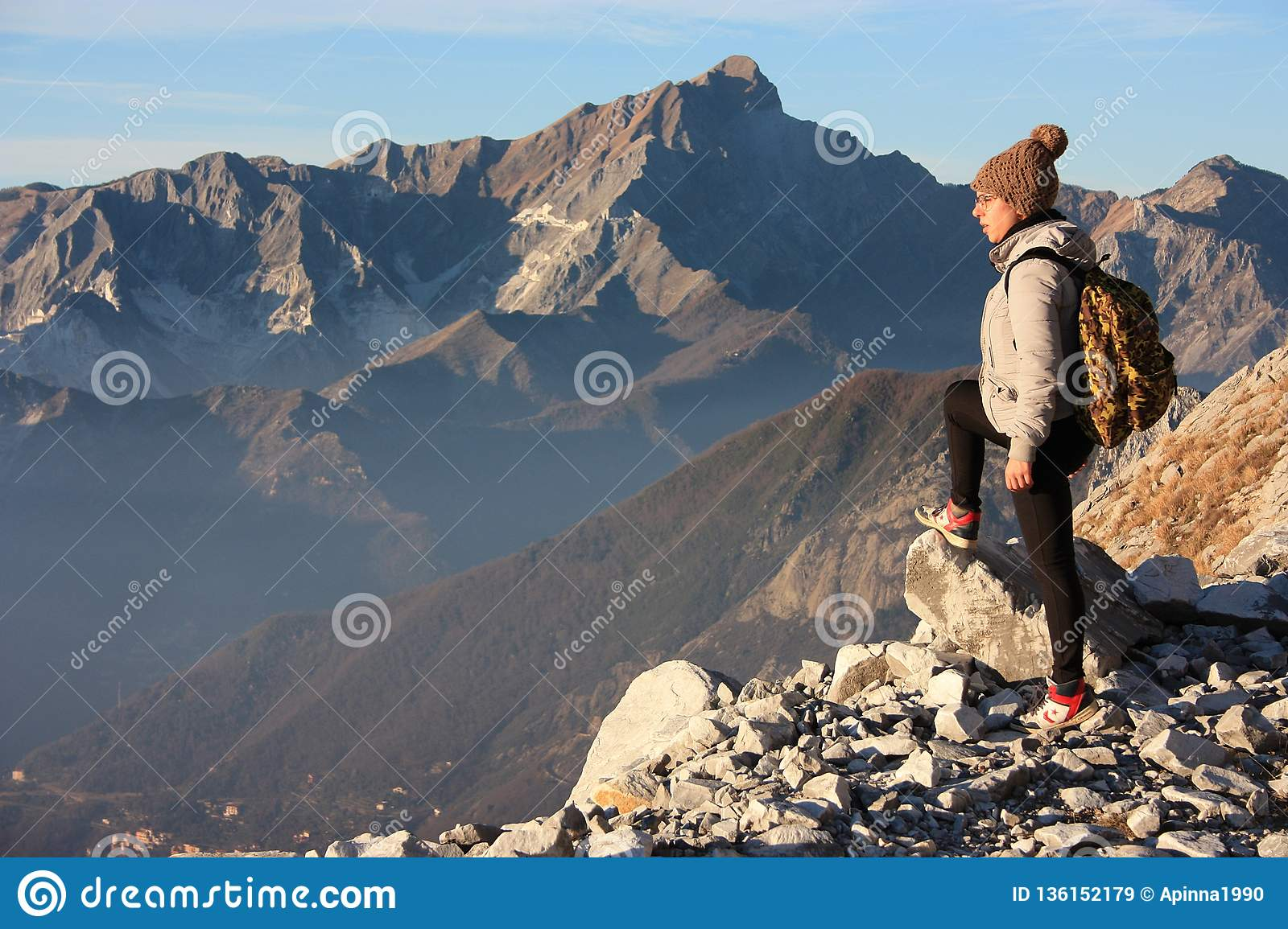 A young woman makes trekking on a mountain