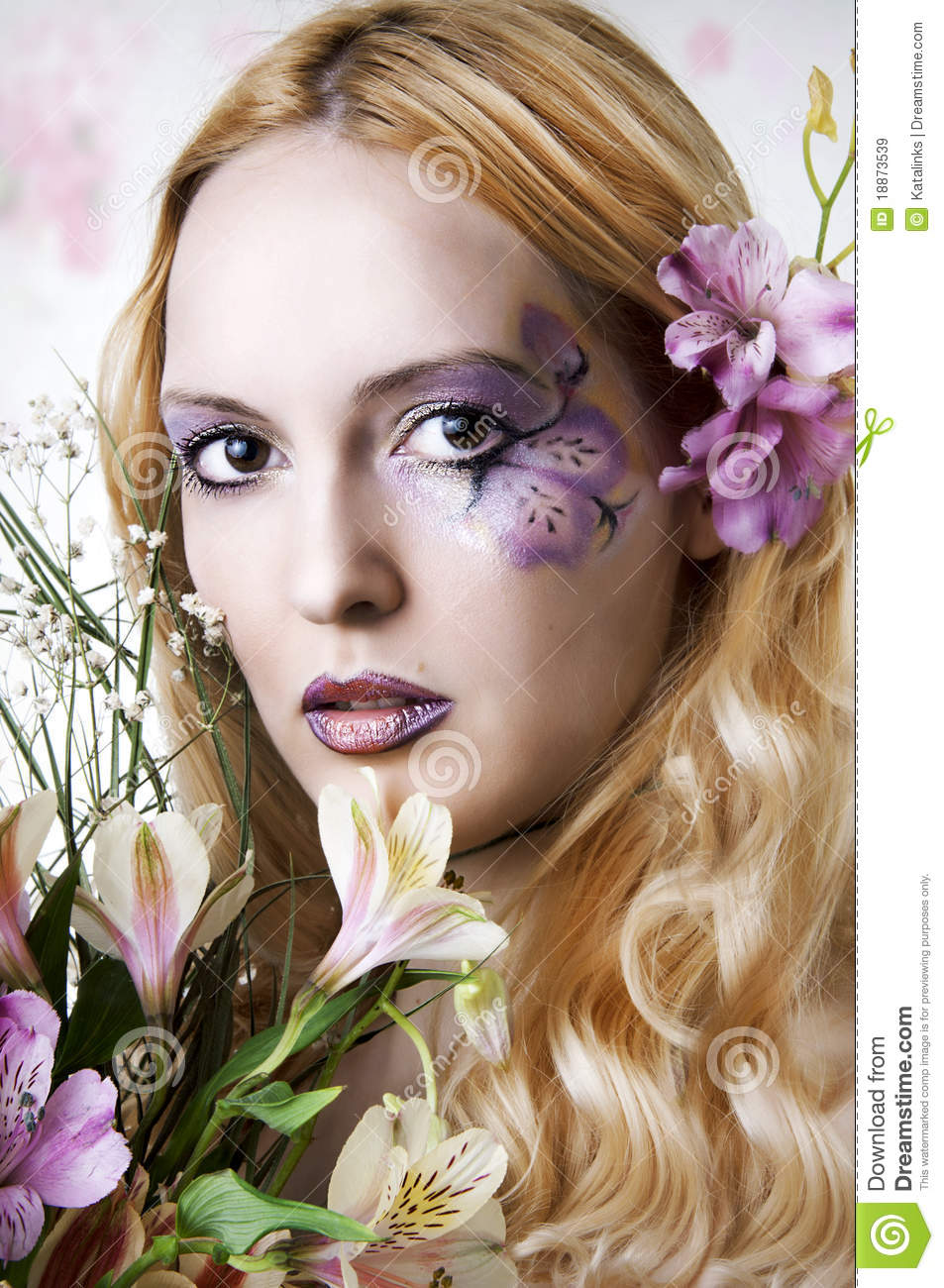 Young Woman With Makeup And Exotic Flowers Stock Image