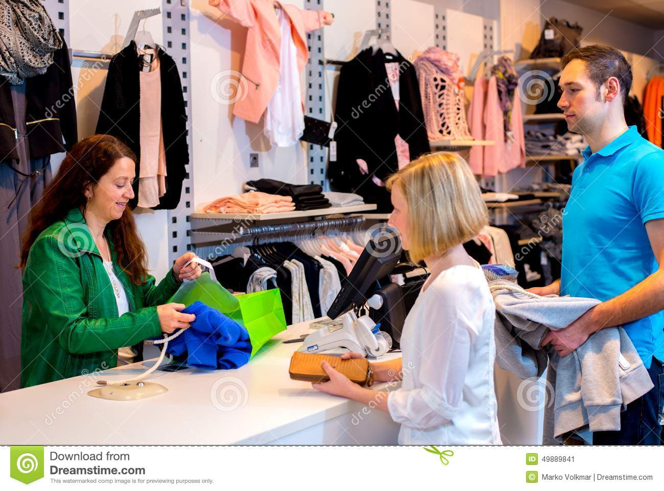 young shop assistant selling clothing in shop royalty stock young w and man in the clothes shop stock image