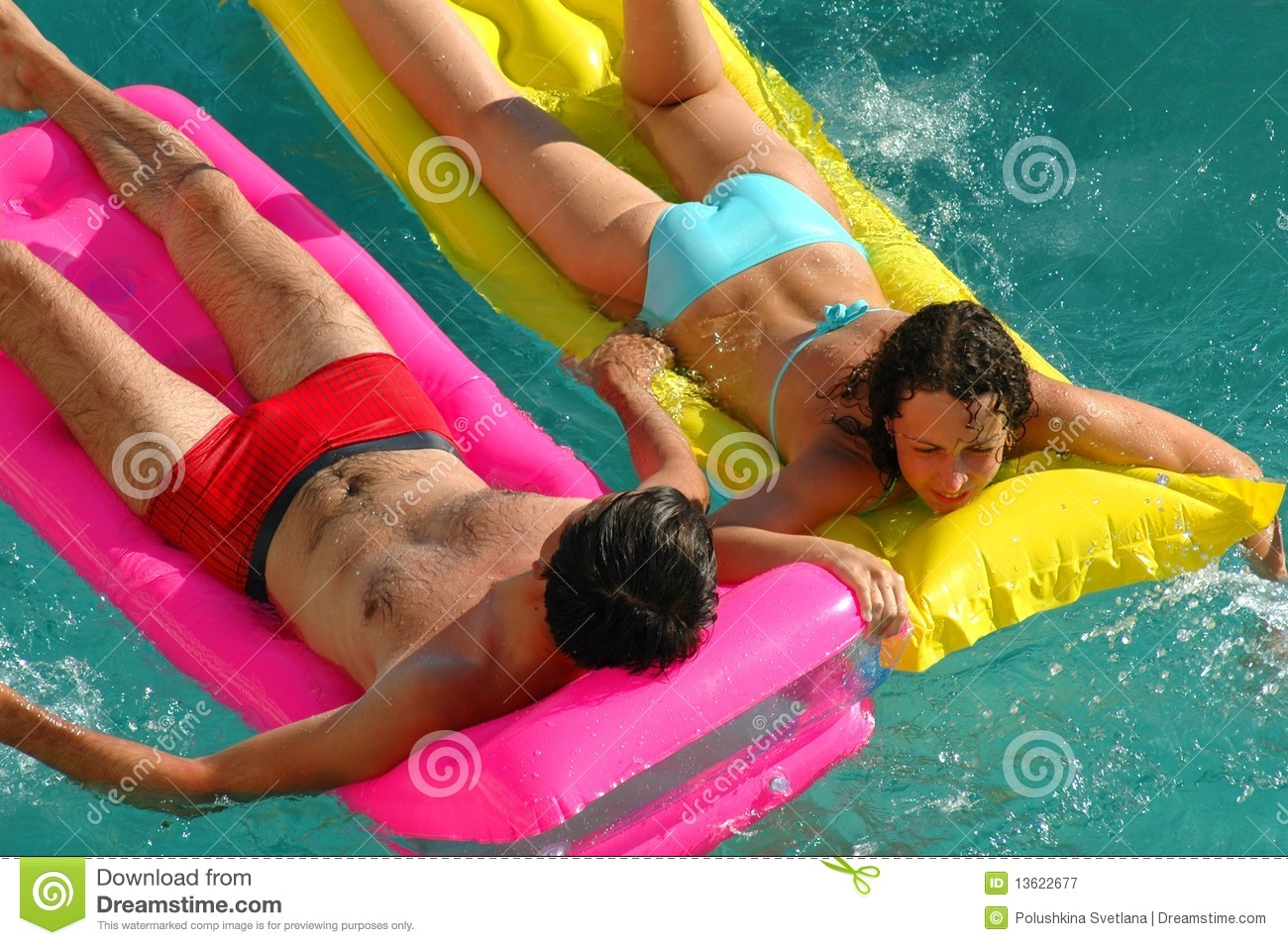 Young woman and the man floating on a mattress