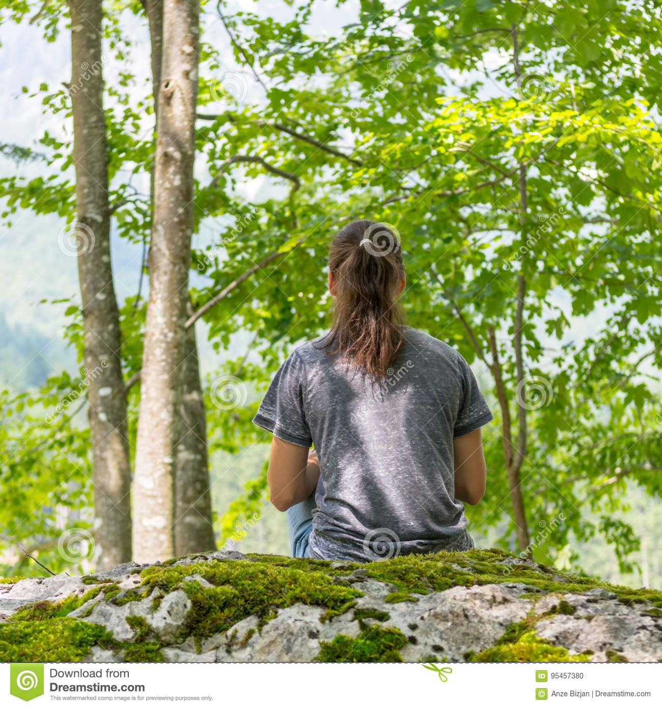 Young Woman Doing Yoga Meditation In Deep Forest High-Res