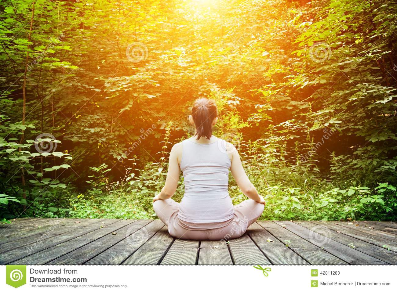 Young woman meditating in a forest. Zen, meditation, healthy breathing