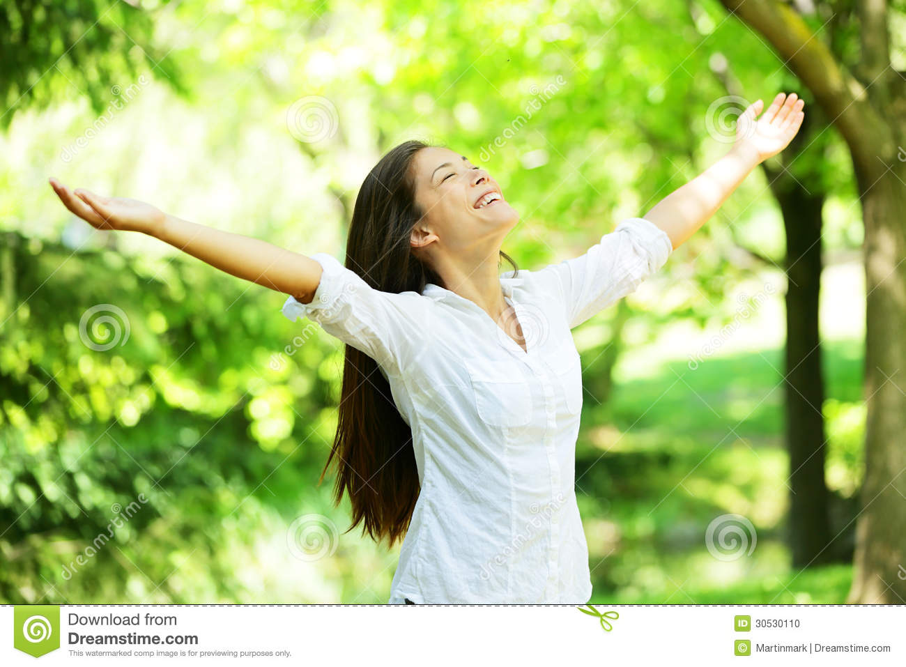 Young woman meditating with open arms