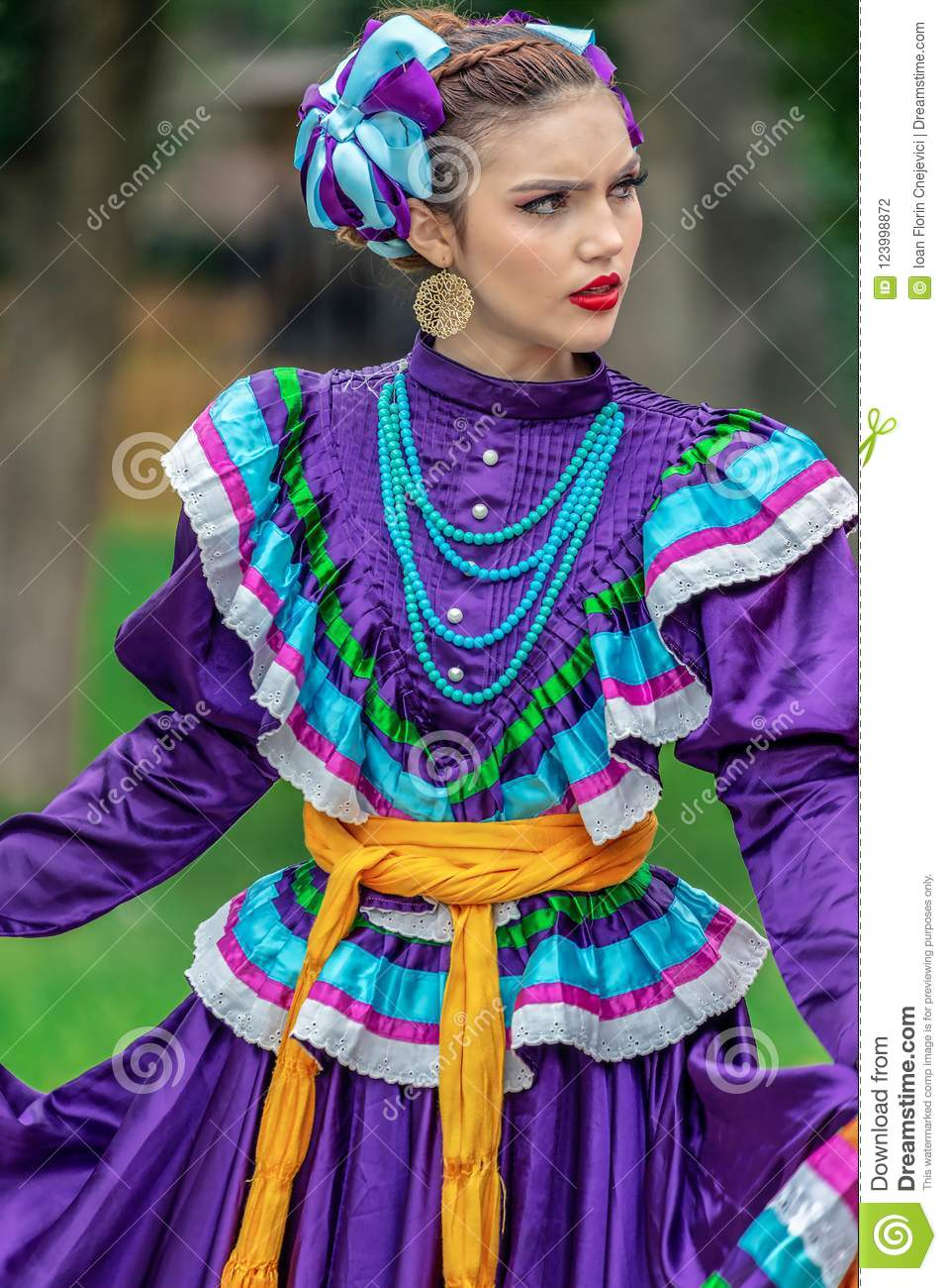young woman from mexico in traditional costume editorial photography