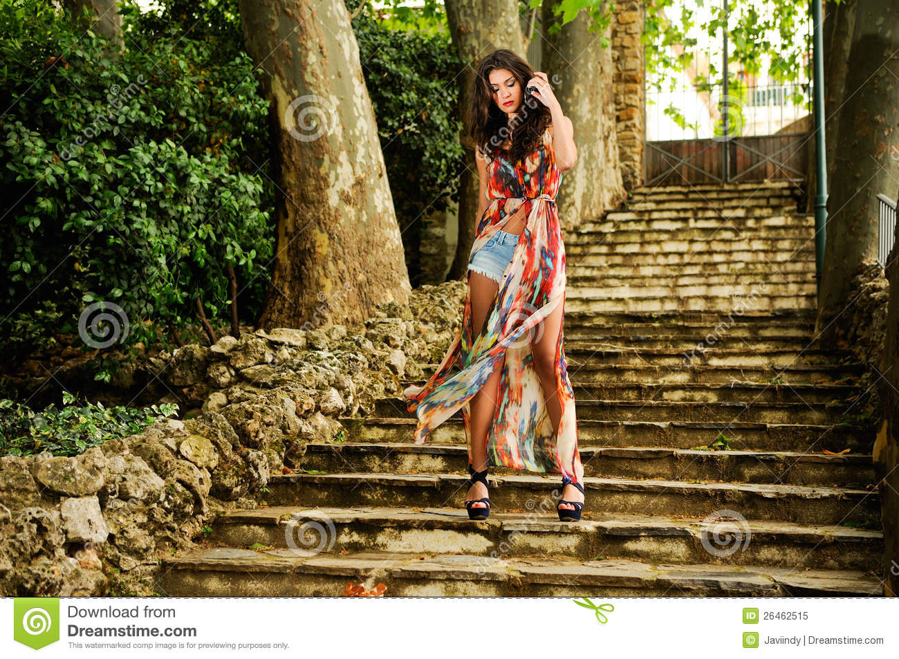 Young woman, model of fashion, in a garden stairs