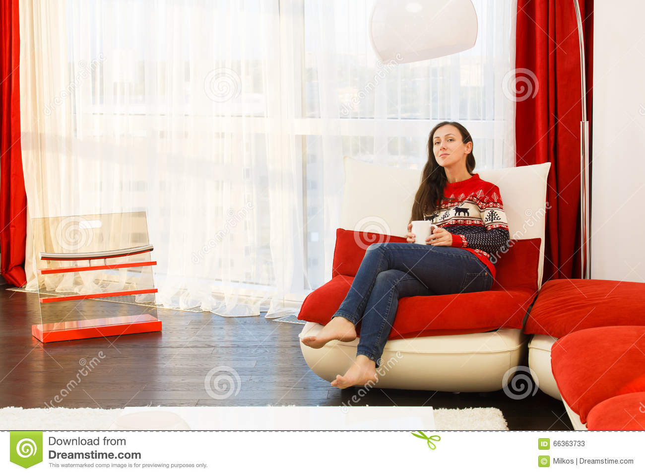Young woman in modern interior living room drinks coffee for Young modern living room