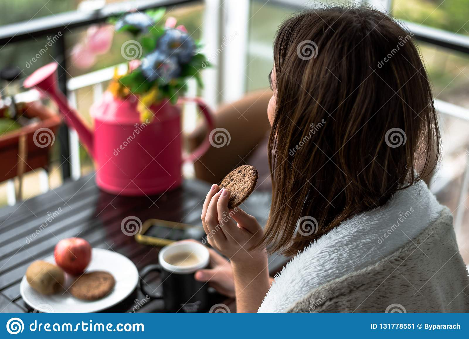 Young woman with a morning breakfast