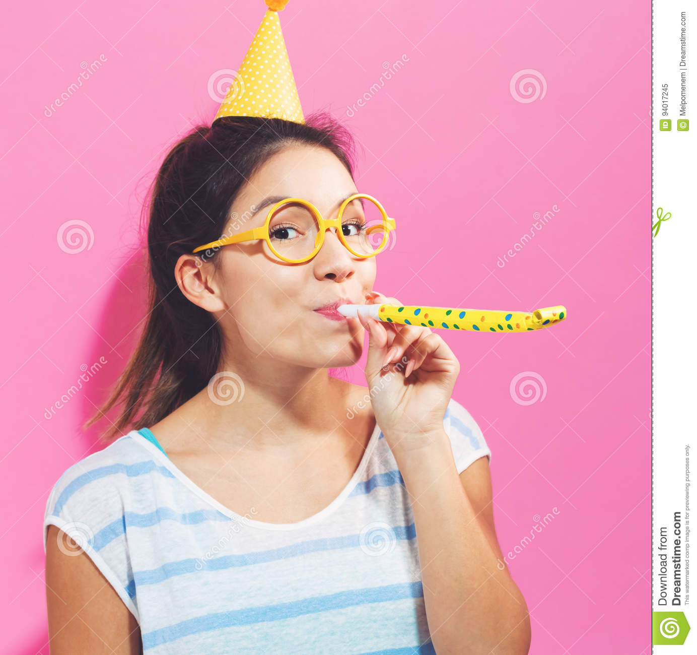 Young woman with noisemaker