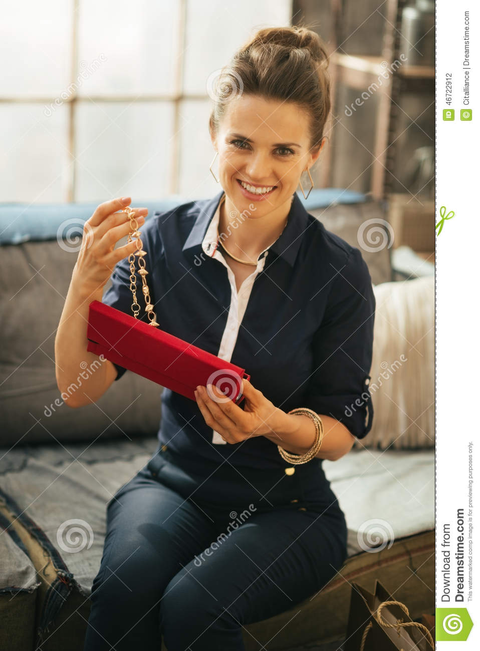 Young woman opening jewelry