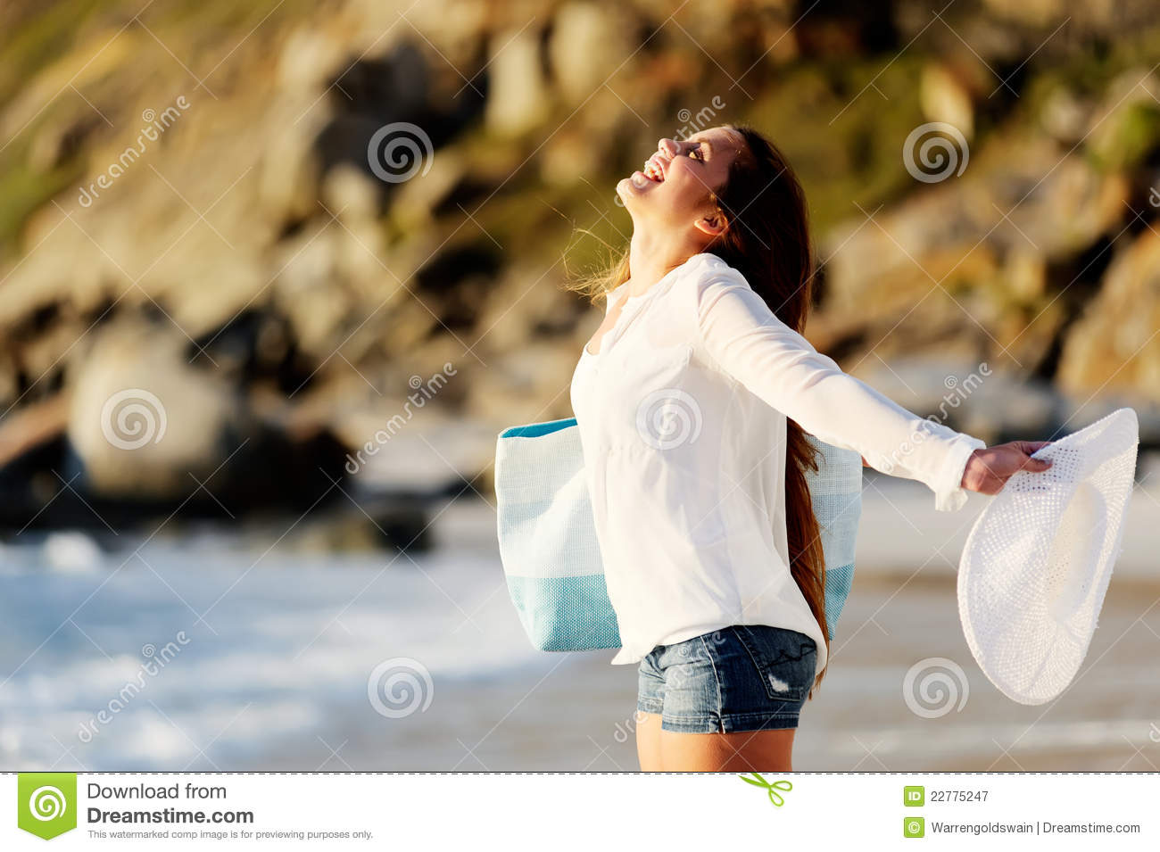 Young woman opens her arms to the surroundings