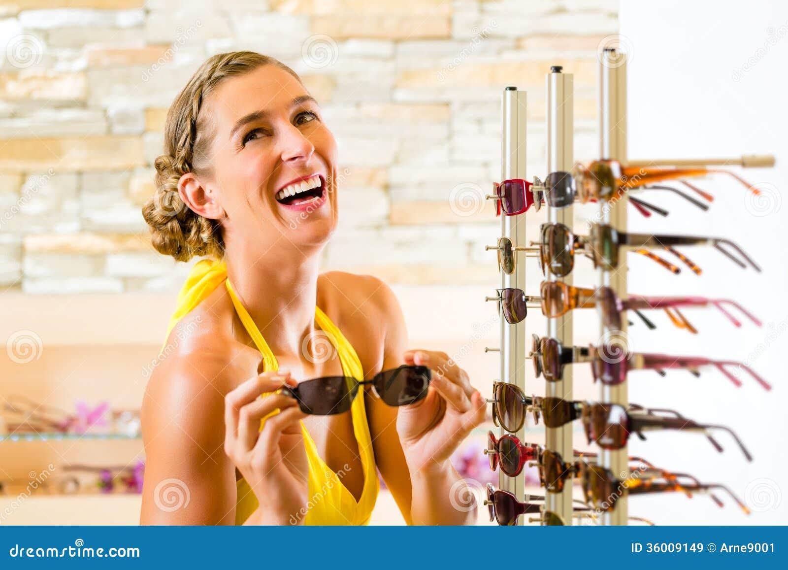 Young woman at optician shopping sunglasses