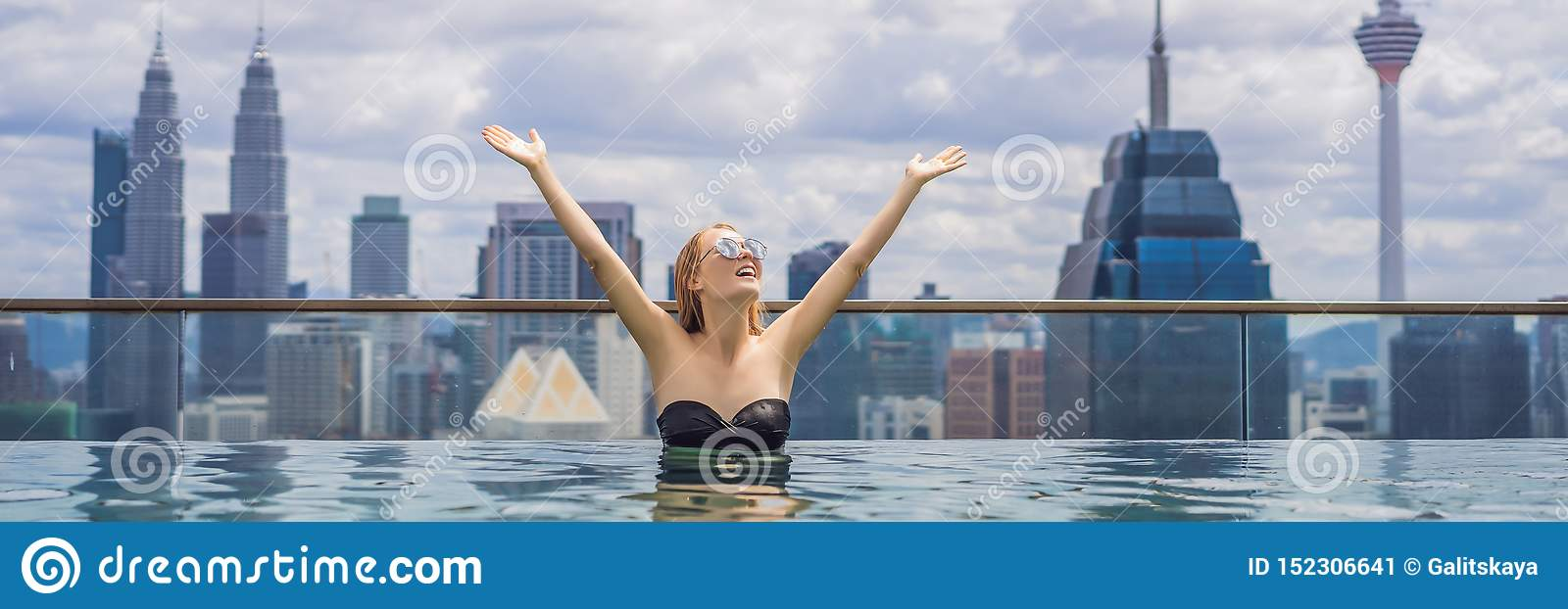 Young woman in outdoor swimming pool with city view in blue sky. Rich people BANNER, LONG FORMAT